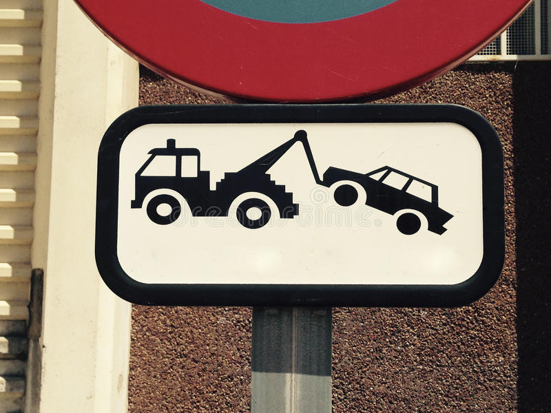 No parking signal. Traffic sign outdoors. Traffic signs no parking and evacuation on tow truck stock photography