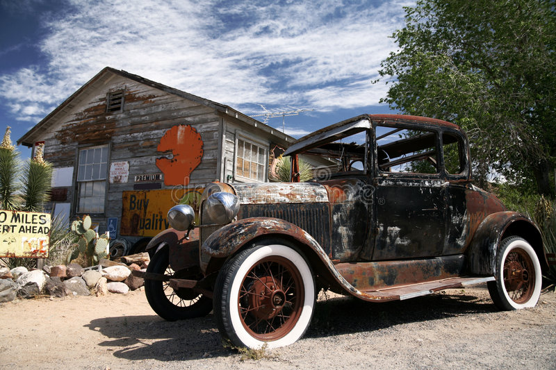 Old american ford beside vintage house. The old american ford beside vintage house royalty free stock photography