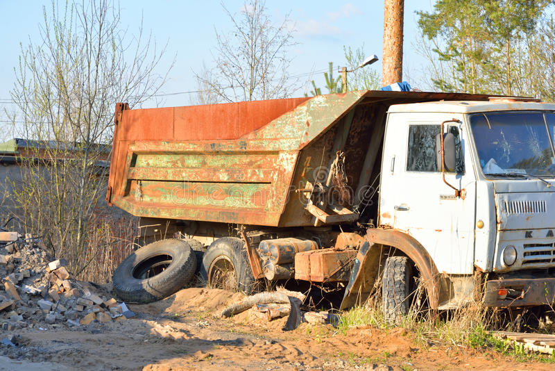 Old broken truck KAMAZ. ULYANOVKA, RUSSIA - 1 MAY 2016: Old broken truck KAMAZ - tipper, produced the Kama Automobile Plant. Intended for transportation of bulk stock photo
