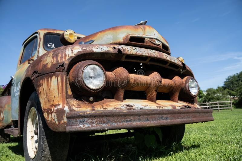 Rusty old ford truck with blue sky background. Old rusty ford truck, with blue sky background, sits in a field, August 10, 2019, Leesport, Pennsylvania, USA royalty free stock photos