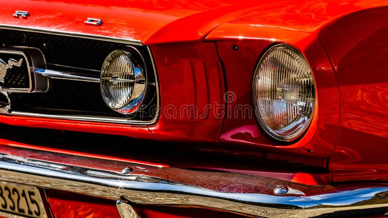 Old red Ford Mustang. Spider of `60s years royalty free stock image