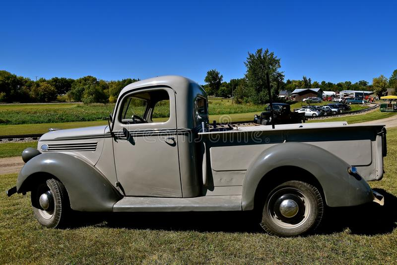 Old restored Ford pickup at a farm show. DALTON, MINNESOTA, Sept 8 2017: An old restored Ford pickup is parked near the railroad tracks at the annual Dalton stock photography