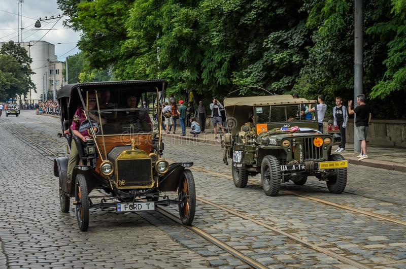 LVIV, UKRAINE - JUNE 2018: Old vintage retro car Ford T and army jeep Willys drive through the streets of the city. Old vintage retro car Ford T and army jeep stock photo