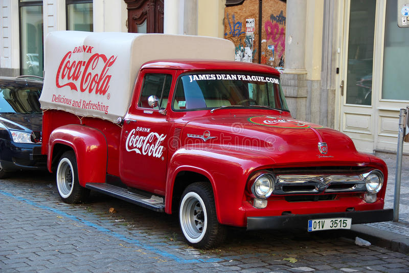 PRAGUE, CZECH REPUBLIC - Oct 23 2015: An old renovated red Ford vintage Coca cola truck in a parking lot. PRAGUE, CZECH REPUBLIC - Oct 23 2015: An old renovated royalty free stock photo