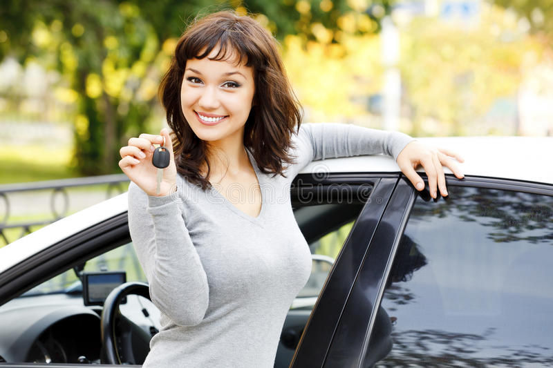 Pretty asian girl with car. Pretty asian girl showing the car key stock photos