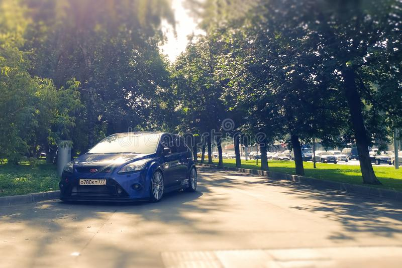 Russia, Moscow - May 04, 2019: Blue hot hatchback Ford Focus RS Parked on the sidewalk. Violates parking rules. Racing car on the stock photography