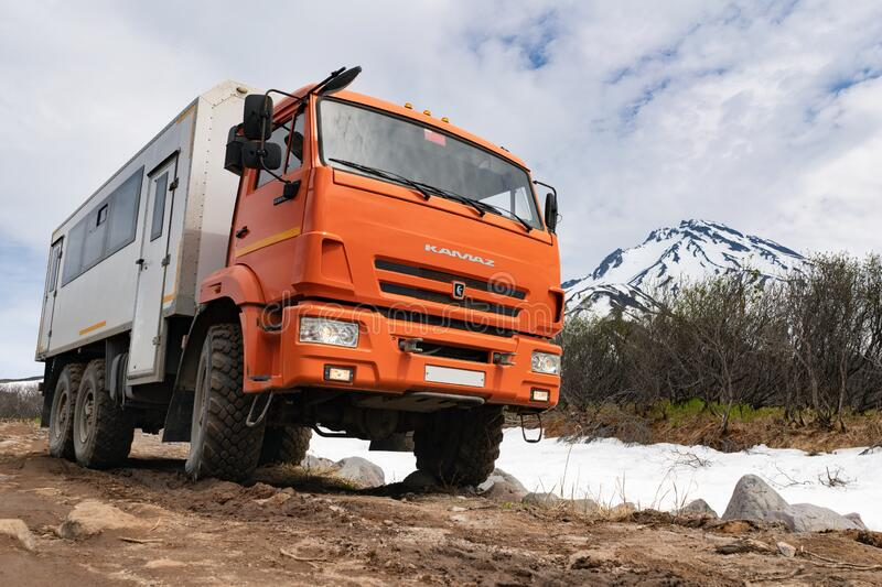 Russian off-road passenger expedition truck KamAZ on mountain road. In direction popular travel destinations for mountain climbing on Vilyuchinsky Volcano stock photos