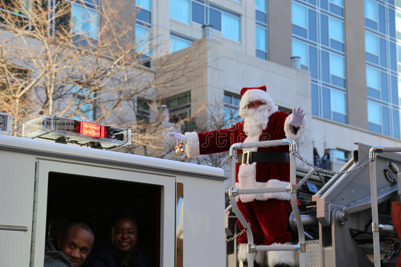 Santa Waving From Ladder Fire Truck stock photo