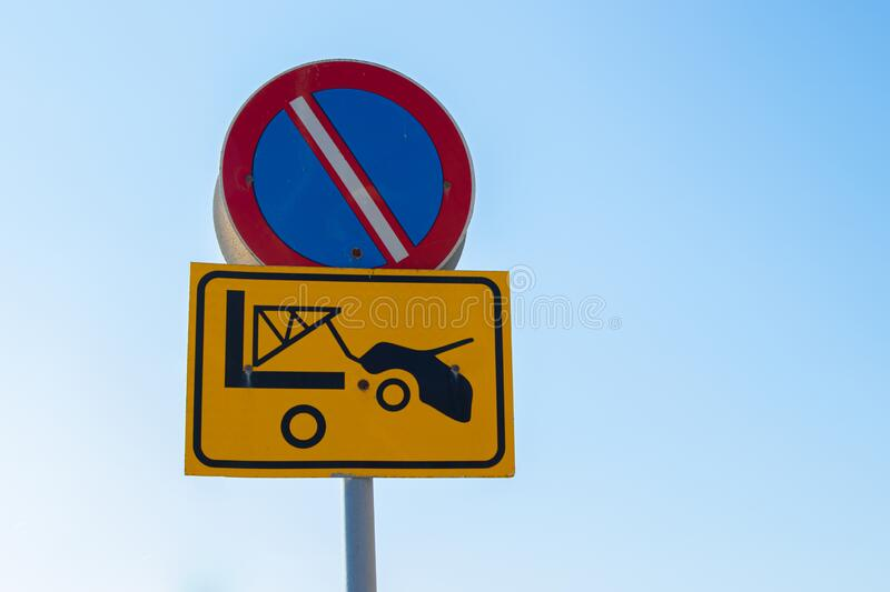 Traffic sign - No Parking zone, evacuation on tow truck. Prohibited and tow away zone.  royalty free stock image