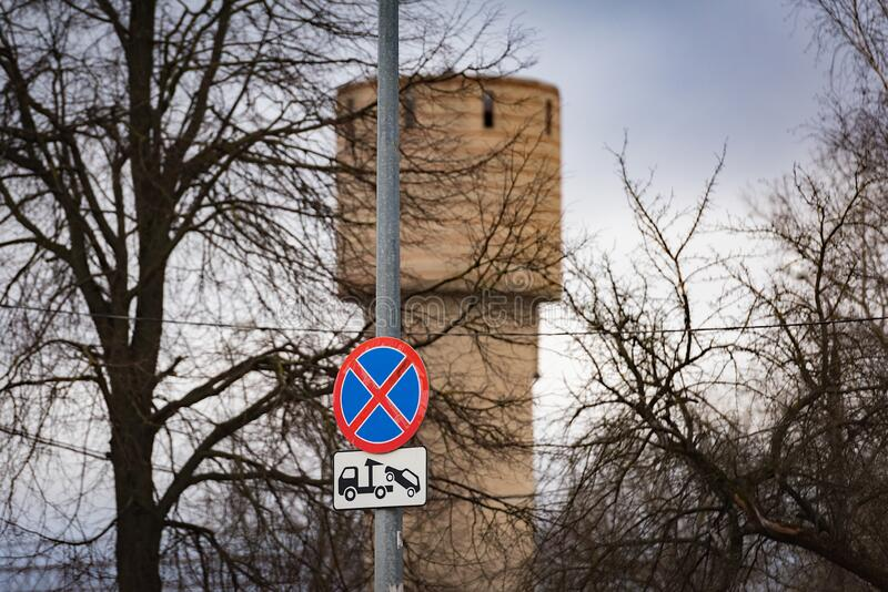 Traffic sign warning no parking and car evacuation. From the city street royalty free stock photography
