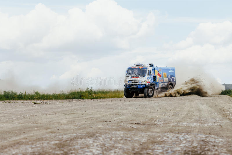 Truck rally car KAMAZ turn on a dust road. Filimonovo, Russia - July 10, 2017: truck rally car KAMAZ turn on a dust road during Silk way rally royalty free stock image
