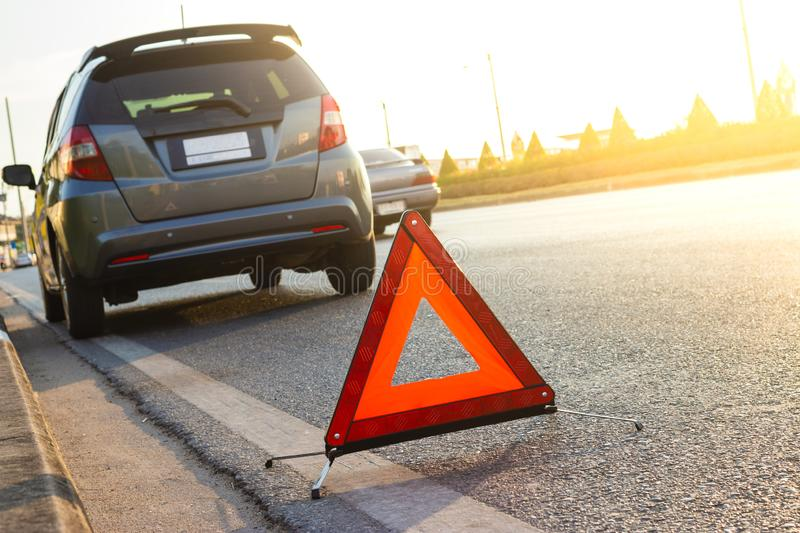 Unexpected situation, Emergency stop sign and broken city car on road. Car, emergency,road royalty free stock image