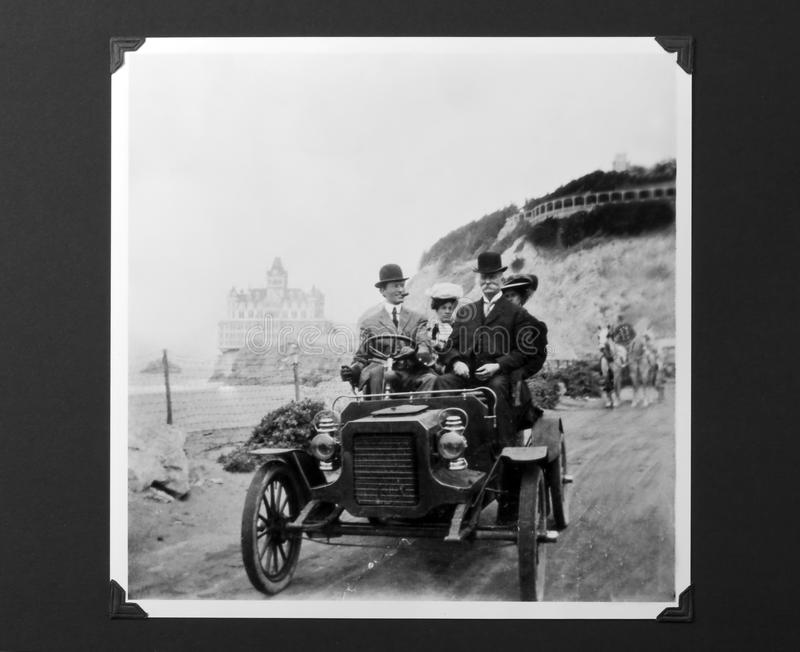 Vintage Auto Photo, Model T Ford with Passengers. Circa 1900 model-T Ford with men in bowler hats (driver is Dr Asa W Collins) and women in backseat. This road stock photo