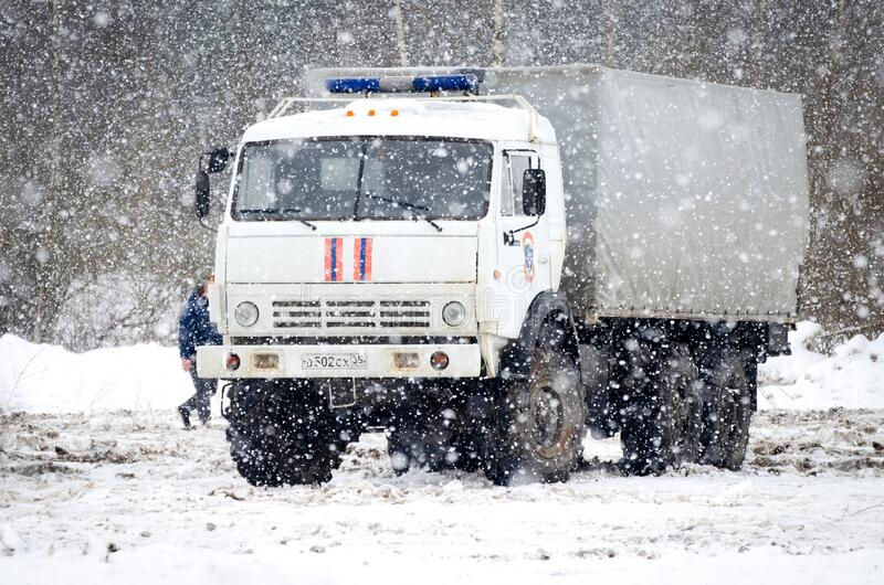 Russian emergency rescue vehicle EMERCOM on chassis Kamaz in snowfall. VOLOGDA, RUSSIA - FEBRUARY 28, 2020: Russian emergency rescue vehicle EMERCOM on chassis stock photos