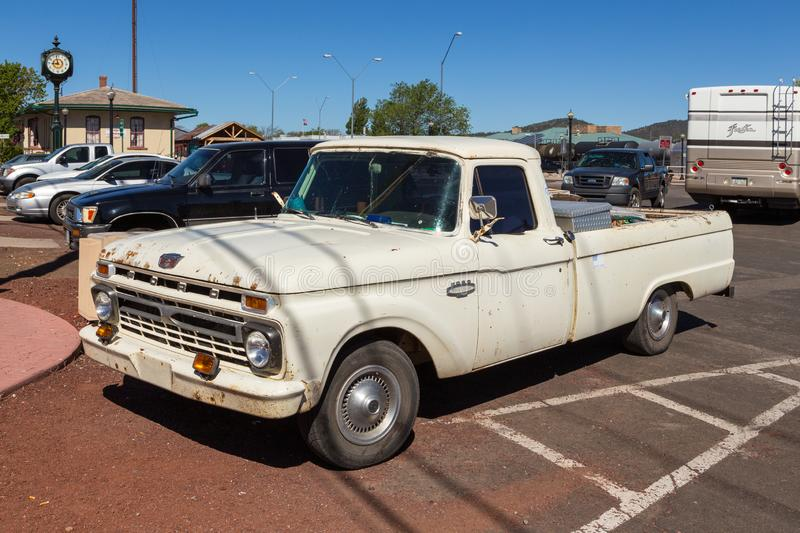Old, historic Ford on parking in the center of town, Williams, USA. Williams, Arizona, USA- 01 June 2015: Old, historic Ford on parking in the center of town stock image